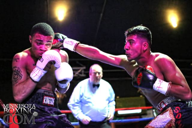 Celso Ramirez (right) lands a right hand in his pro debut last September.