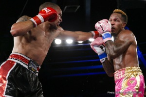 Robert Brant, left, lands one of many hard jabs to tough opponent Louis Rose last October on Showtime. Photo credit Esther Lin/Showtime.