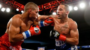 Rob Brant lands a hard right hand to the jaw of Decarlo Perez. Photo Credit: Esther Lin/Showtime