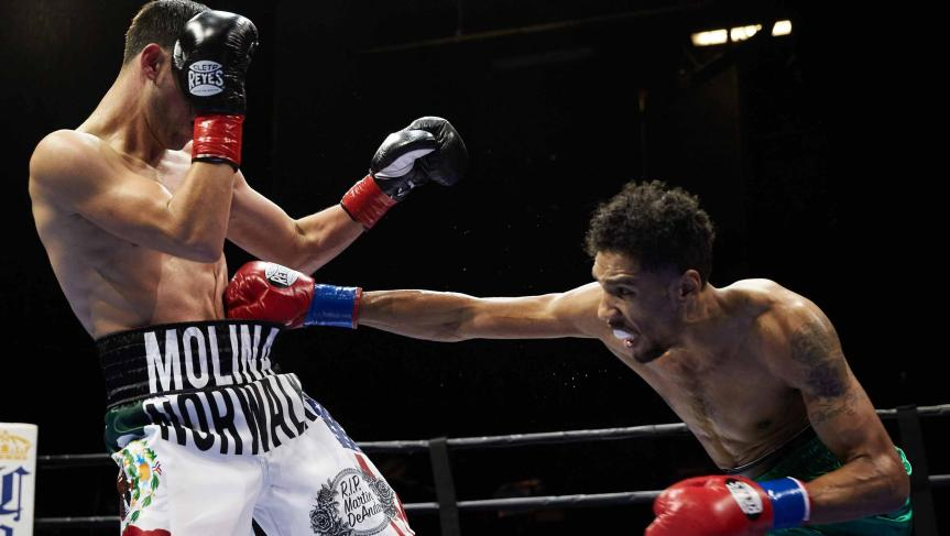 Jamal James stretches to land a right on Javier Molina. (Suzanne Teresa / Premier Boxing Champions)