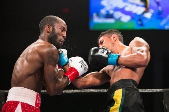 Jamal James lands a right hand to Yordenis Ugas last Friday night on ESPN. Photo courtesy of Premier Boxing Championships
